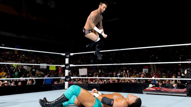 CM Punk flies to drill Darren Young with an elbow on Raw.  (Courtesy WWE)