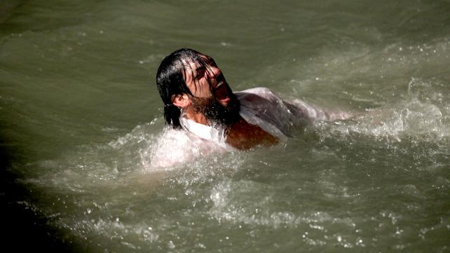 Damien Sandow learns to swim the old-fashioned way thanks to Cody Rhodes. (Courtesy of WWE)