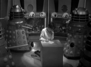 The daleks bully Susan as they dictate a note