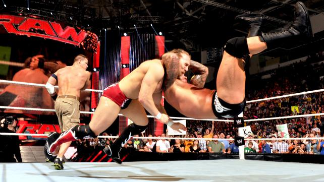 "Randy Orton makes Daniel Bryan pay for ""accidentally"" knocking him out of the ring. (Courtesy WWE)"