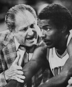 The colorful Guy Lewis coaches up Clyde Drexler at the University of Houston.