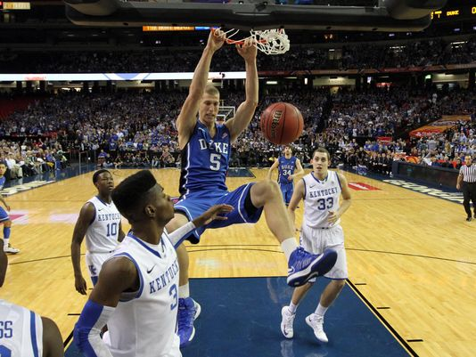 Duke center Mason Plumlee scores against Kentucky's Nerlens Noel on route to a 75-68 win at the second Champions Classic in Atlanta.
