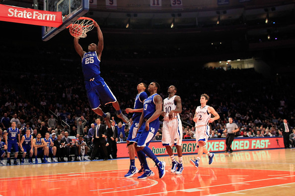 Kentucky point guard Marquis Teague flushes it home during a victory over Kansas in the first ever Champions Classic.