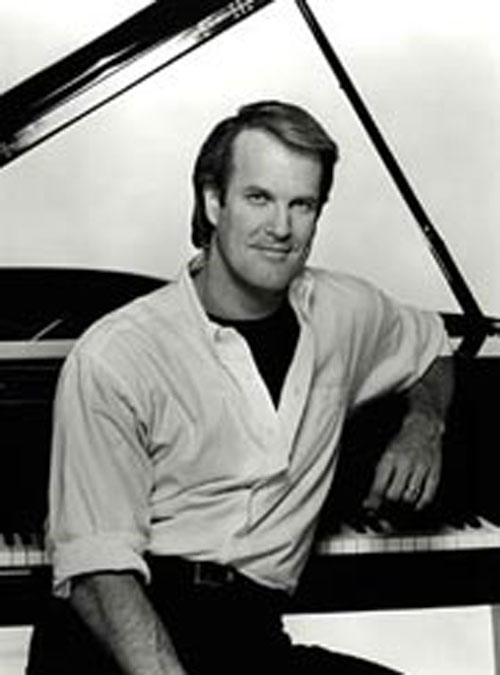 Entertainment Tonight led a show with news of Superman's death. Here's then-host John Tesh doing something.