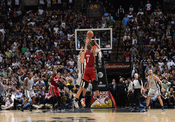 The Miami Heat's Chris Bosh makes a game-winning three-pointer against the San Antonio Spurs.