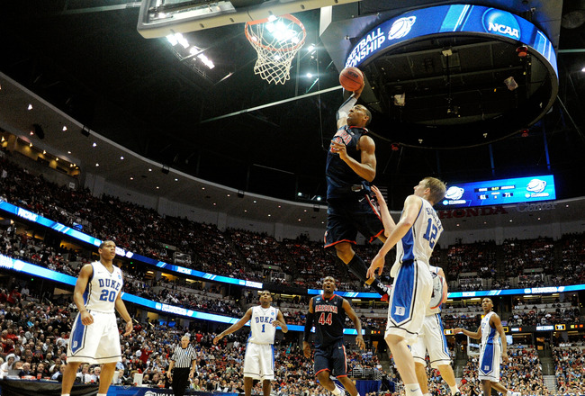 One of Miller's first recruits as Arizona head coach, Derrick Williams, skies in for a punctuating dunk in a 2011 tournament win over defending champion Duke.