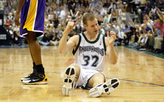 Hoiberg celebrates a made shot as a member of the Minnesota Timberwolves in the 2004 Western Conference Finals.