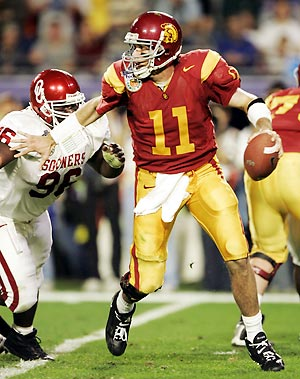 Heisman Trophy winner Matt Leinart makes good on his award by slicing up Oklahoma for 5 TD's in a 55-19 Orange Bowl win.