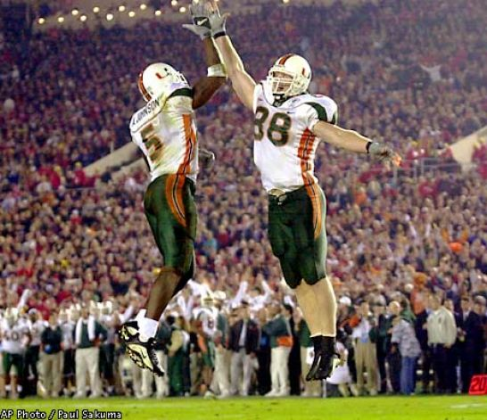 Andre Johnson and Jeremy Shockey celebrate a touchdown as the Miami Hurricanes routed the Nebraska Cornhuskers in the Rose Bowl.