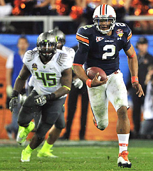 Auburn's do-everything Heisman winner Cam Newton runs away from the Oregon Ducks defense in the 2010 B.C.S. Championship Game.