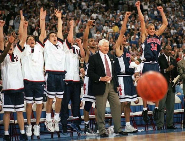 Lute Olson and the Arizona bench celebrate the Wildcats' overtime victory over Kentucky to win the 1997 national championship.