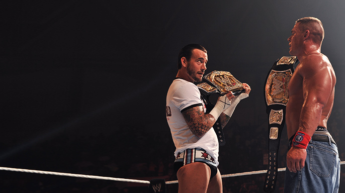 C.M. Punk and John Cena compare belt sizes during their memorable WWE Championship feud in the summer of 2011.