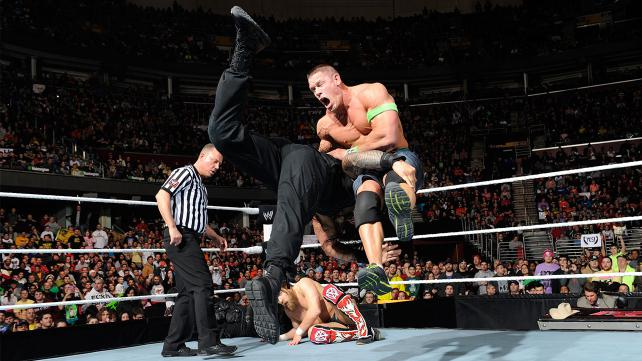 Roman Reigns spears John Cena as part of RAW's main event (courtesy WWE.com)