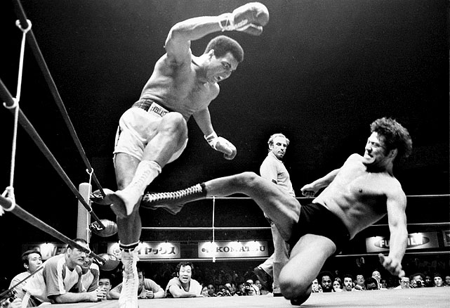 "Muhammad Ali fights Antonio Inoki in a ""boxer vs. wrestler"" match in 1976. It was aired on closed circuit television as the main event of a super card at Shea Stadium by Vince McMahon, Sr."