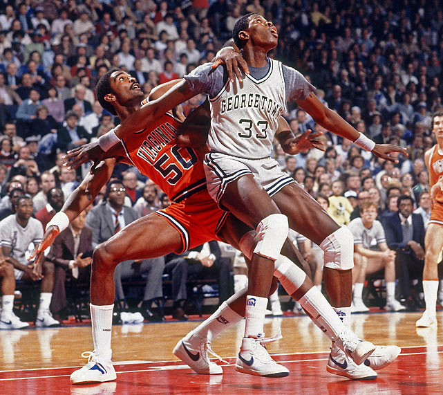 Georgetown's Patrick Ewing and Virginia's Ralph Sampson do battle in the paint. Ewing and Sampson are two of the last three players to be three-time All-Americans.