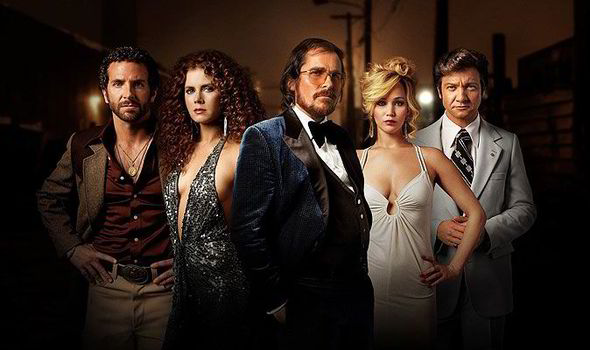 """The cast of """"American Hustle."""" Four of the five actors in this promotional still were nominated for Oscars, including Amy Adams for Best Actress."""