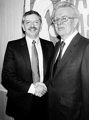 Stern shakes hands with his mentor Larry O'Brien, who retired as commissioner in 1984 on the eve of the NBA's popularity boom.