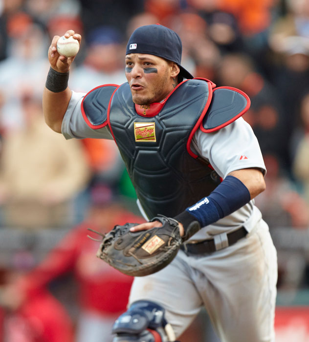 Catcher Yadier Molina will guide the Cardinals' young, but stellar, pitching staff this year.