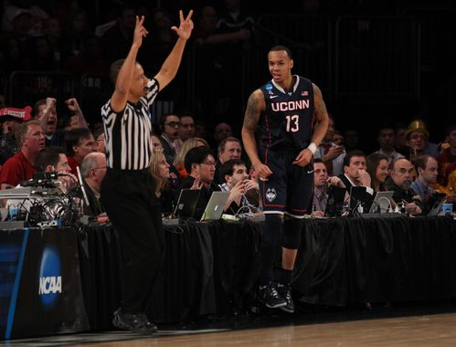 Three years after his teammate Kemba Walker did it, Shabazz Napier is carrying UConn back to the Final Four.