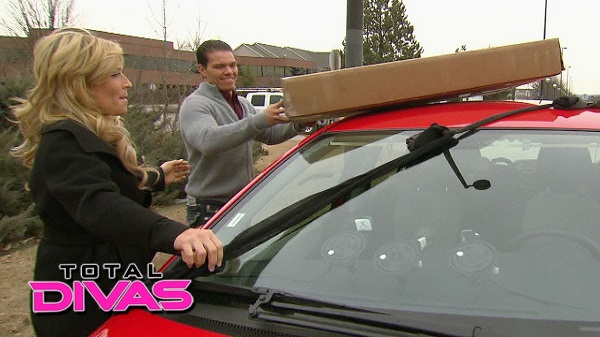 """This answers the question """"How many Hart family members does it take to strap something to a car? (More than two)"""""""