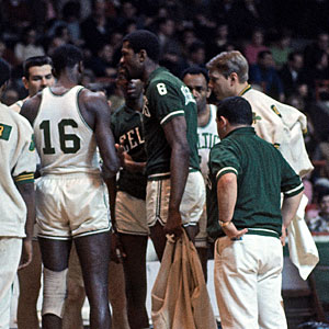 Bill Russell coaches the Boston Celtics in the huddle. Russell played for and coached the Celtics to two straight NBA titles in 1968 and '69.