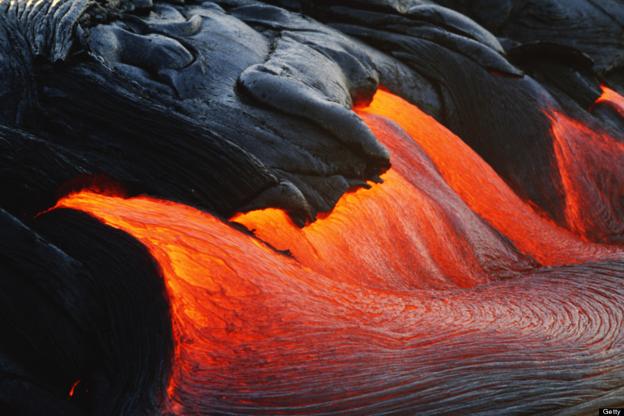 Glowing streams of lava pouring during eruption of Kilauea volcano