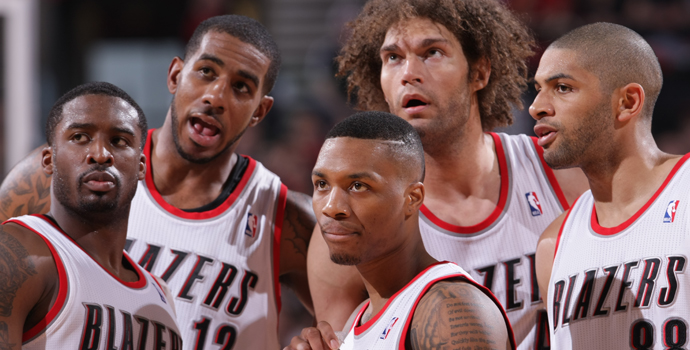 PORTLAND, OR - APRIL 27: The Portland Trail Blazers stand on the court during a game against the Houston Rockets in Game Four of the Western Conference Quarterfinals during the 2014 NBA Playoffs on April 27, 2014 at the Moda Center in Portland, Oregon. NOTE TO USER: User expressly acknowledges and agrees that, by downloading and or using this photograph, User is consenting to the terms and conditions of the Getty Images License Agreement. Mandatory Copyright Notice: Copyright 2014 NBAE (Photo by Sam Forencich/NBAE via Getty Images)