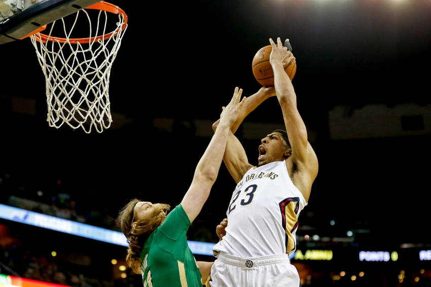 Mar 16, 2014; New Orleans, LA, USA; New Orleans Pelicans forward Anthony Davis (23) shoots over Boston Celtics center Kelly Olynyk (41) during the first quarter of a game at the Smoothie King Center. Mandatory Credit: Derick E. Hingle-USA TODAY Sports