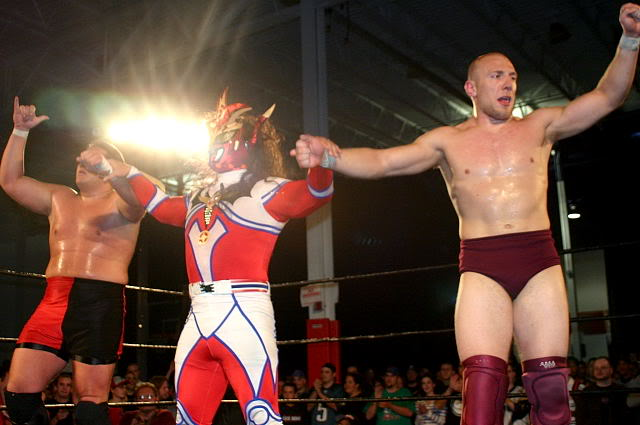 Jushin Liger with Samoa Joe and Bryan Danielson in 2004