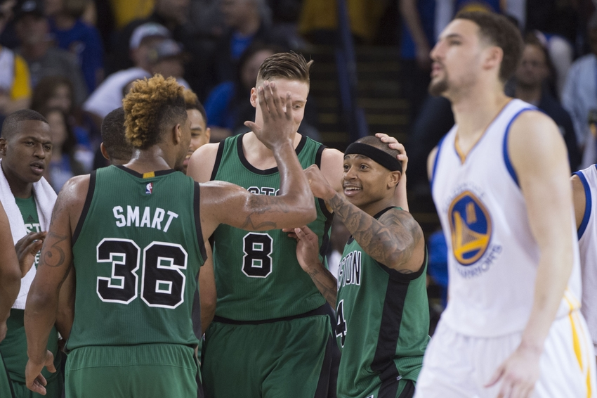 April 1, 2016; Oakland, CA, USA; Boston Celtics guard Isaiah Thomas (4) celebrates with guard Marcus Smart (36) against Golden State Warriors guard Klay Thompson (11, far right) during the fourth quarter at Oracle Arena. The Celtics defeated the Warriors 109-106. Mandatory Credit: Kyle Terada-USA TODAY Sports