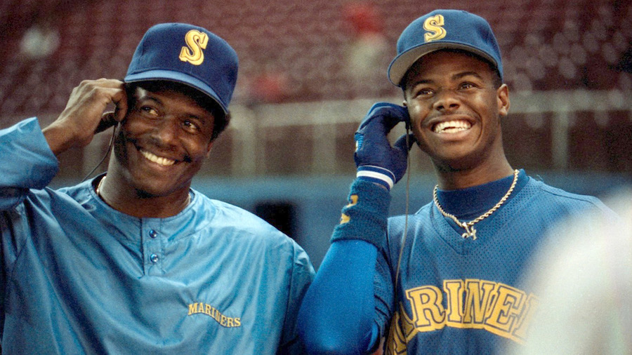 The Griffeys, the first father-son duo to play as teammates in MLB history. Listening to Jock Jamz. Probably.