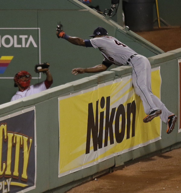 Tigers outfielder Torii Hunter, about to flip over the right field fence in Fenway as Papi's grand slam ends up in the bullpen catcher's mitt.