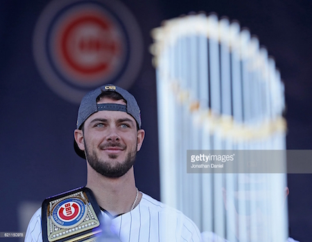 NL MVP Kris Bryant also won a World Series trophy, and, if you check his right shoulder, a WWE Championship.